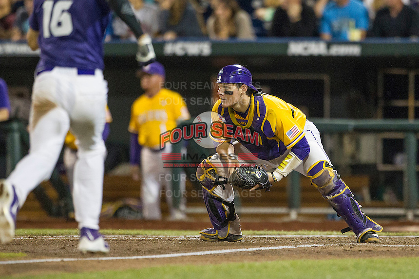 LSU Tigers catcher Kade Scivicque (22) blocks the plate against the TCU Horned Frogs in Game 10 of the NCAA College World Series on June 18, 2015 at TD Ameritrade Park in Omaha, Nebraska. TCU defeated the Tigers 8-4, eliminating LSU from the tournament. (Andrew Woolley/Four Seam Images)