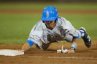 UCLA pinch hitter Brett Urabe (44) dives back to first base against the North Carolina State Wolfpack during Game 8 of the 2013 Men's College World Series on June 18, 2013 at TD Ameritrade Park in Omaha, Nebraska. The Bruins defeated the Wolfpack 2-1, eliminating North Carolina State from the tournament. (Andrew Woolley/Four Seam Images)