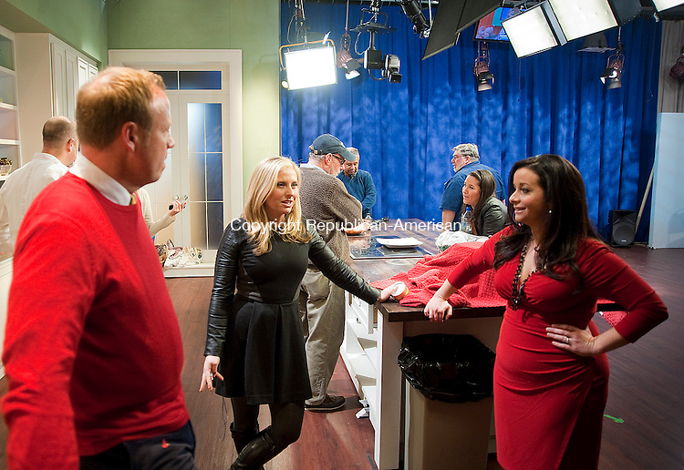 ROCKY HILL, CT-121313JS05-Waterbury native Jamie Calli Mascia, the Executive Producer for Better Connecticut on WFSB, right, chats with on-air personalities Scot Haney and Kara Sundlun at their studios in Rocky Hill following a taping of Better Connecticut on Friday. <br /> Jim Shannon Republican-American