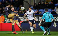 Bolton Wanderers' Josh Magennis competing with Sheffield Wednesday's Tom Lees, Michael Hector and Keiren Westwood <br /> <br /> Photographer Andrew Kearns/CameraSport<br /> <br /> The EFL Sky Bet Championship - Bolton Wanderers v Sheffield Wednesday - Tuesday 12th March 2019 - University of Bolton Stadium - Bolton<br /> <br /> World Copyright © 2019 CameraSport. All rights reserved. 43 Linden Ave. Countesthorpe. Leicester. England. LE8 5PG - Tel: +44 (0) 116 277 4147 - admin@camerasport.com - www.camerasport.com