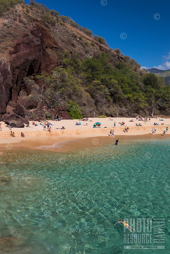 Snorkelers and beachgoers enjoy a clear day at Makena Beach, Maui.