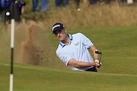 Russell Knox (SCO) chips from a bunker at the 14th green during Thursday's Round 1 of the 145th Open Championship held at Royal Troon Golf Club, Troon, Ayreshire, Scotland. 14th July 2016.<br /> Picture: Eoin Clarke | Golffile<br /> <br /> <br /> All photos usage must carry mandatory copyright credit (&copy; Golffile | Eoin Clarke)