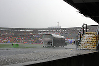 BOGOTA - COLOMBIA -21 -12-2014: Fuerte aguacero cayo sobre el estadio Nemesio Camacho El Campin, previo al partido de vuelta entre Independiente Santa Fe y Deportivo Independiente Medellin por la final de la Liga Postobon II-2014, en el estadio Nemesio Camacho El Campin de la ciudad de Bogota. / Heavy rain fell on the Nemesio Camacho El Campin stadium, before the match for the second leg between Independiente Santa Fe and Deportivo Independiente Medellin for the final of the Liga Postobon II-2014, at the Nemesio Camacho El Campin stadium in the city of Bogota.  Photo: VizzorImage / Nestor Silva / Cont.