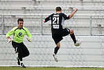 19 May 2012: Carolina's Brian Shriver (21) completes his first half hat trick with this goal past PSA Elite's Trevor Whiddon (left). He scored four goals in the game. The Carolina RailHawks (NASL) defeated the PSA Elite (USASA) 6-0 at WakeMed Soccer Stadium in Cary, NC in a 2012 Lamar Hunt U.S. Open Cup second round game.