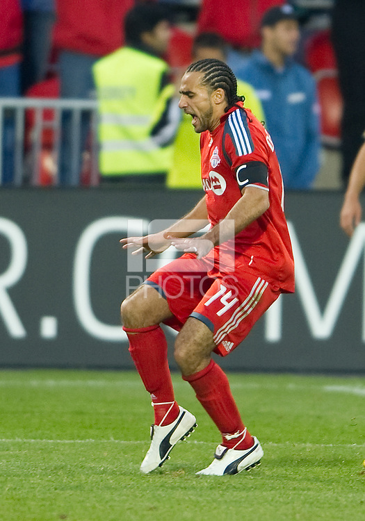 "15 April 2010: Toronto FC midfielder Dwayne De Rosario #14 does his patented ""shake & bake"" celebration after scoring a goal during a game between the Philadelphia Union and Toronto FC at BMO Field in Toronto..Toronto FC won 2-1..Photo by Nick Turchiaro/isiphotos.com."