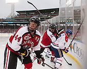 Dax Lauwers (NU - 44), Matt Benning (NU - 5), Ryan McGrath (UML - 10) - The Northeastern University Huskies defeated the University of Massachusetts Lowell River Hawks 4-1 (EN) on Saturday, January 11, 2014, at Fenway Park in Boston, Massachusetts.