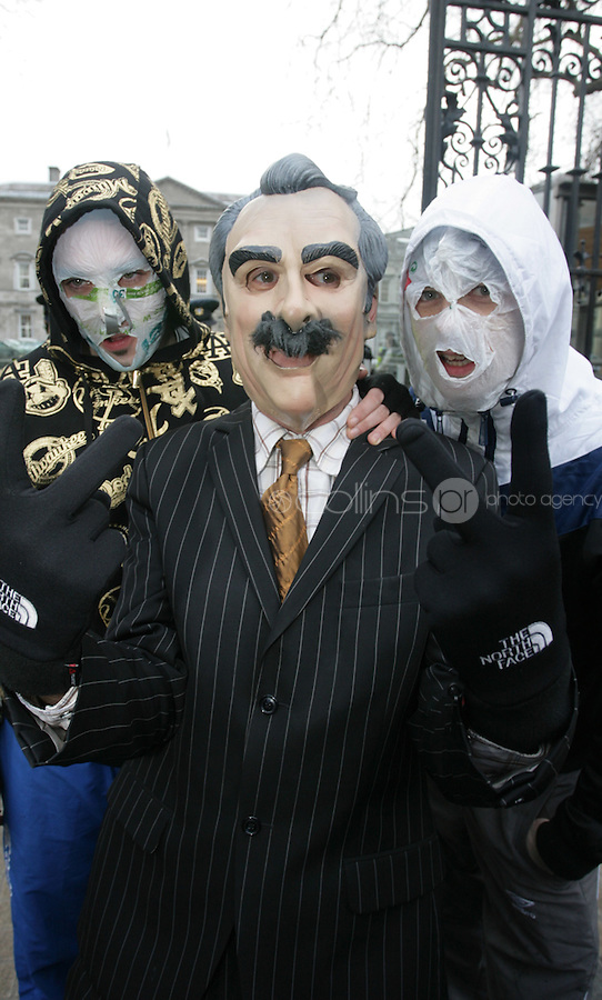 """15/12/2010.Members of The Rubber Bandits (L to r).Blind Boy Boathouse.Mr Chrome .with a Willie O' Dea Lookalike.at the launch of their new single """"Horse Outside"""" which is a song about horses .outside Leinster House on Kildare Street , Dublin..Photo: Gareth Chaney Collins"""