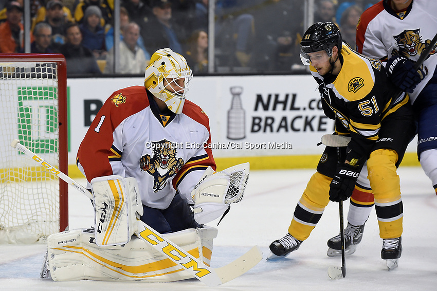 Thursday, March 24, 2016: Boston Bruins center Ryan Spooner (51) looks at the puck caught in Florida Panthers goalie Roberto Luongo's (1) glove during the National Hockey League game between the Florida Panthers and the Boston Bruins held at TD Garden, in Boston, Massachusetts. Eric Canha/CSM