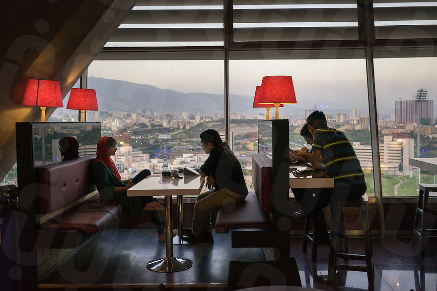 June 15, 2014 - Tehran (Iran). People chat inside one of the common spaces of Milad Tower. Also known as Tehran Tower, it stands at 435m and it's the sixth tallest tower in the world. © Thomas Cristofoletti / Ruom