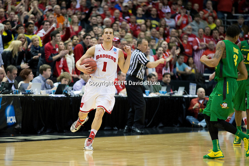 Wisconsin Badgers guard Ben Brust (1) celebrates during the third-round game in the NCAA college basketball tournament against the Oregon Ducks Saturday, April 22, 2014 in Milwaukee. The Badgers won 85-77. (Photo by David Stluka)