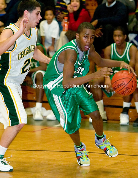 WATERBURY, CT-- 09 JANUARY 2008--011808JS11-Wilby's Damien Saunders(31) drives past Holy Cross' Rob Mannetti (21)  during their game Friday at Holy Cross High School. <br /> Jim Shannon/Republican-American