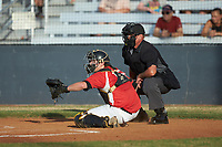 Lake Norman Copperheads catcher Damon Massey (15) (West Virginia St) sets a target as home plate umpire Britt Kennerly looks on during the game against the Mooresville Spinners at Moor Park on July 6, 2020 in Mooresville, NC.  The Spinners defeated the Copperheads 3-2. (Brian Westerholt/Four Seam Images)