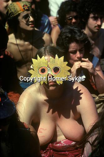 Stonehenge, Wiltshire. 1979<br /> A bare breasted hippy celebrates the Celtic mythological Sun God Belenus during the summer solstice on 21st of June.