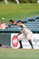 Dayton Dragons first baseman Robert Ramirez (25) stretches for a pick off attempt throw during a game against the South Bend Silver Hawks on August 20, 2014 at Four Winds Field in South Bend, Indiana.  Dayton defeated South Bend 5-3.  (Mike Janes/Four Seam Images)