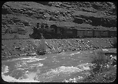 RGS #455 with southbound freight train along red wall section near Sawpit.<br /> RGS  Saw Pit (near), CO  Taken by Maxwell, John W. - 5/30/1948