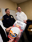 SOUTHBURY, CT- 4 December 2014-120414EC03--   Southbury Fire Marshal Barry Rickert holds some o the free smoke dectectors he's giving away during the holiday season at Town Hall Thursday. Behind him is Deputy Fire Marshall Tim Baldwin. Erin Covey Republican-American