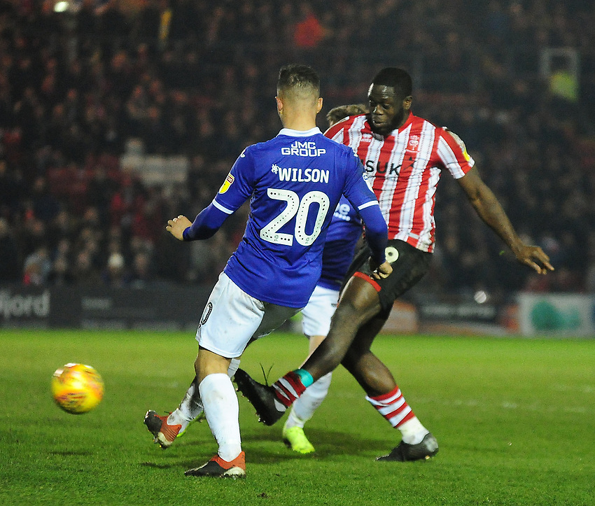 Lincoln City's John Akinde scores the late equaliser to make the score 1-1<br /> <br /> Photographer Andrew Vaughan/CameraSport<br /> <br /> The EFL Sky Bet League Two - Lincoln City v Exeter City - Tuesday 26th February 2019 - Sincil Bank - Lincoln<br /> <br /> World Copyright © 2019 CameraSport. All rights reserved. 43 Linden Ave. Countesthorpe. Leicester. England. LE8 5PG - Tel: +44 (0) 116 277 4147 - admin@camerasport.com - www.camerasport.com