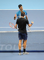 Novak Djokovic (SRB) and Roger Federer (SUI) shake hands at the end of the match during Day Eight of the Barclays ATP World Tour Finals 2015 played at The O2, London on November 22nd 2015