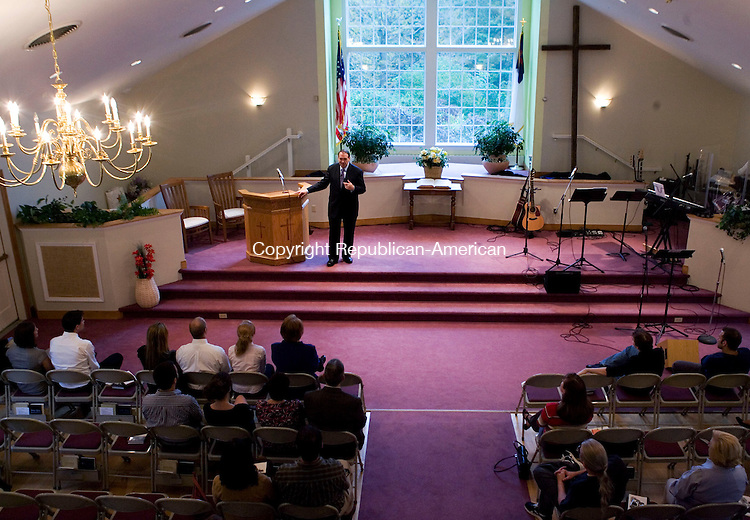 NEW MILFORD, CT - 28 SEPTEMBER 2008 -092808JT05--<br /> Former Arkansas governor and one-time presidential candidate Mike Huckabee delivers a sermon as a guest during Sunday morning's service at Northville Baptist Church in New Milford. Huckabee, an ordained Southern Baptist minister, also joined in the church's musical group for a song as bass guitarist. To see a photo gallery of the event, visit www.rep-am.com.<br /> Josalee Thrift Republican-American