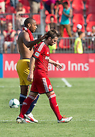 July 20, 2013: New York Red Bulls forward Thierry Henry #14 comforts Toronto FC midfielder Bobby Convey #15 at the end of a game between Toronto FC and the New York Red Bulls at BMO Field in Toronto, Ontario Canada.<br /> The game ended in a 0-0 draw.