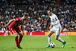 Gareth Bale (R) of Real Madrid is tackled by Joshua Kimmich of FC Bayern Munich during the UEFA Champions League Semi-final 2nd leg match between Real Madrid and Bayern Munich at the Estadio Santiago Bernabeu on May 01 2018 in Madrid, Spain. Photo by Diego Souto / Power Sport Images