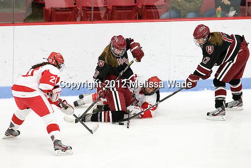 Isabel Menard (BU - 20), Kalley Armstrong (Harvard - 13), Kayla Tutino (BU - 8), Kaitlin Spurling (Harvard - 17) - The Boston University Terriers defeated the visiting Harvard University Crimson 2-1 on Sunday, November 18, 2012, at Walter Brown Arena in Boston, Massachusetts.