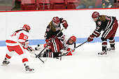 Isabel Menard (BU - 20), Kalley Armstrong (Harvard - 13), Kayla Tutino (BU - 8), Kaitlin Spurling (Harvard - 17) - The Boston University Terriers defeated the visiting Harvard University Crimson 2-1 on Sunday, November 18, 2012, at Walter Brown Arena in Boston, Massachusetts.