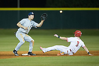 Kyle Smith (24) of the Catawba Indians waits for the throw as Kennan Stanley (3) of the Belmont Abbey Crusaders steals second base at Abbey Yard on February 7, 2017 in Belmont, North Carolina.  The Crusaders defeated the Indians 12-9.  (Brian Westerholt/Four Seam Images)