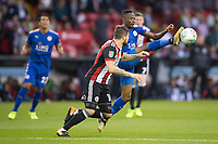 Ahmed Musa of Leicester City gets to the ball ahead of Kieron Freeman of Sheffield United during the Carabao Cup match between Sheffield United and Leicester City at Bramall Lane, Sheffield, England on 22 August 2017. Photo by James Williamson / PRiME Media Images.