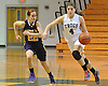 Kacey Burden #27 of Carle Place, right, looks to dribble past Christina Testa #22 of Oyster Bay during the Nassau County varsity girls basketball Class B final at LIU Post on Thursday, Feb. 18, 2016. Burden scored a team-high 27 points to lead Carle Place to a 62-58 victory in overtime.