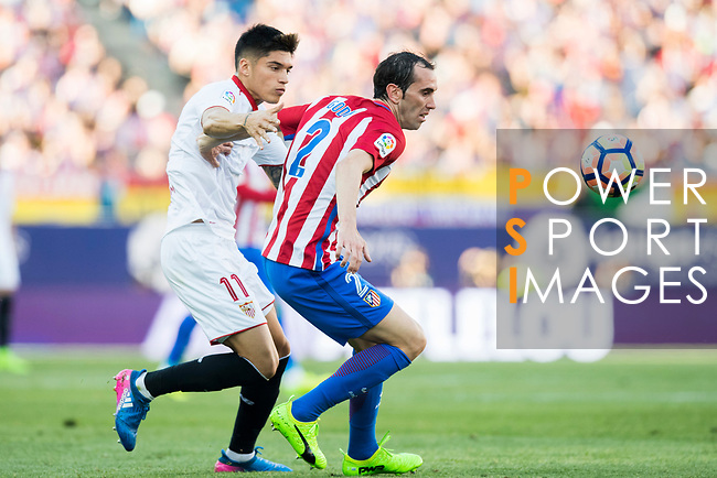 Diego Roberto Godin Leal (r) of Atletico de Madrid is challenged by Carlos Joaquin Correa of Sevilla FC during their La Liga match between Atletico de Madrid and Sevilla FC at the Estadio Vicente Calderon on 19 March 2017 in Madrid, Spain. Photo by Diego Gonzalez Souto / Power Sport Images