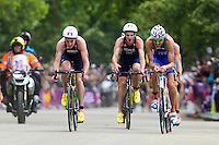 07 AUG 2012 - LONDON, GBR - Alistair Brownlee (GBR) of Great Britain (left) leads the front pack during the bike at the men's London 2012 Olympic Games Triathlon in Hyde Park, London, Great Britain as his brother Jonathan Brownlee (centre), also racing for Great Britain, discovers he has a time penalty for mounting his bike to soon .(PHOTO (C) 2012 NIGEL FARROW)
