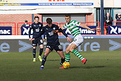17th March 2019, Dens Park, Dundee, Scotland; Ladbrokes Premiership football, Dundee versus Celtic; Filip Benkovic of Celtic challenges for the ball with Ethan Robson of Dundee