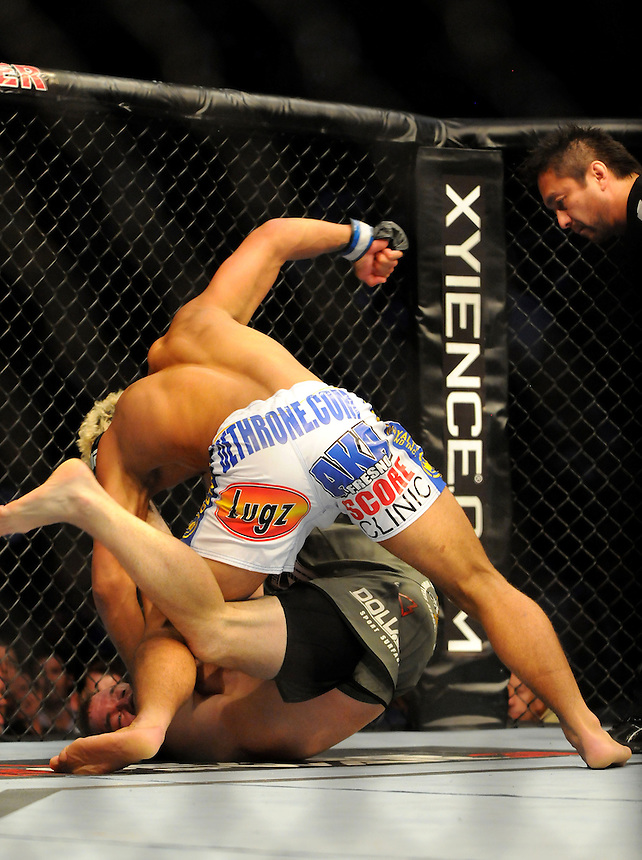 24 SEPTEMBER 2011:   Josh Koscheck beats on the head of Matt Hughes  during UFC 135 at the Pepsi Center in Denver, Colorado. *****For Editorial Use Only*****