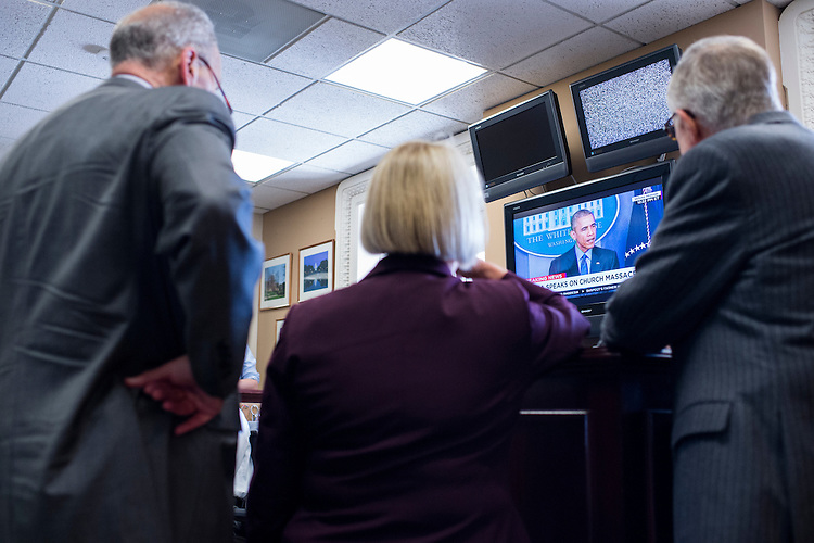 UNITED STATES - JUNE 18: From left, Sen. Chuck Schumer, D-N.Y., Sen. Patty Murray, D-Wash., and Senate Minority Leader Harry Reid, D-Nev., watch President Barack Obama speak about the shooting in Charleston before holding their news conference in the Senate Radio/TV Gallery on budget negotiations on Thursday, June 18, 2015. (Photo By Bill Clark/CQ Roll Call)
