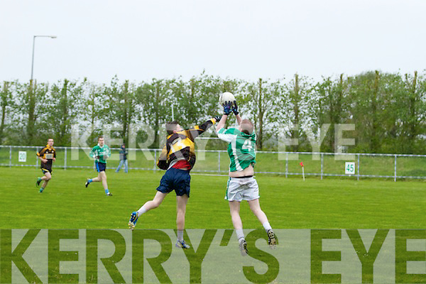 Pictured at the recent match, Clounmacon VS Ballydonoghue in Moyvane on Saturday. Ballydonoghue's Sean Lyons makes a great catch even under pressure from Clounmacon's Bryan McCarthy.