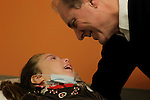 William Massart  smiles with his daughter Sandra Massart, 10, at Duke University Hospital in Durham, NC, USA, on Tuesday, Feb. 14, 2012.  Sandra Massart is being treated for MLD, a degenerative condition.  Photo by Ted Richardson