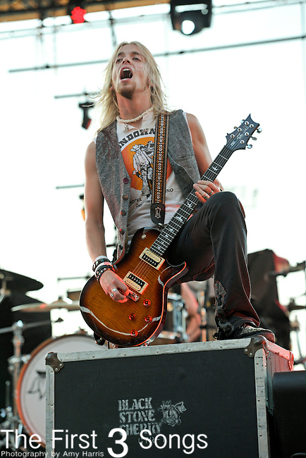 Ben Wells of Black Stone Cherry performs during the Carnival of Madness tour at the Kentucky State Fair's Cardinal Stadium on Friday, August 26, 2011.