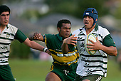 S. Savea is about to be taken from behind by S. Saravanua. Counties Manukau Premier Club Rugby, Pukekohe v Manurewa  played at the Colin Lawrie field, on the 17th of April 2006. Manurewa won 20 - 18.