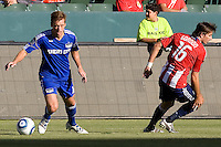 Kansas City Wizards defender Jimmy Conrad turns around CD Chivas USA forward Alan Gordon as he moves with the ball. The Kansas City Wizards defeated CD Chivas USA 2-0 at Home Depot Center stadium in Carson, California on Sunday September 19, 2010.