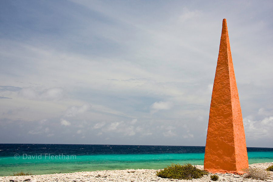 This is one of four Obelisks on Bonaire. Historic landmarks used by the salt traders about 100 years ago. This Orange one, from the Dutch 'House of Orange' is near the salt flats of Pekelmeer, Bonaire Island, Caribbean.