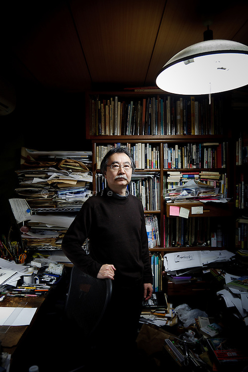 Tokyo, January 10 2012 - Portrait of the Japanese mangaka Taniguchi Jiro in his studio.
