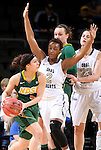 SIOUX FALLS, SD - MARCH 8: Brooke LeMar #4 of NDSU looks to pass the ball against defenders Jorday Doyle #2 and Bernadette Balla #23 of Oral Roberts in the first half of their first round Summit League Championship Tournament game Sunday afternoon at the Denny Sanford Premier Center in Sioux Falls, SD. (Photo by Dave Eggen/Inertia)