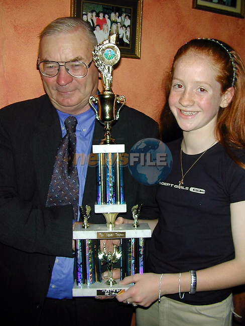 Cora Russell, Tullyallen who won the Best Overall Athlethe of the Year pictured with Tom Neary who sponsered the trophy at the Dunleer A.C. awards night in The Crowing Cock.