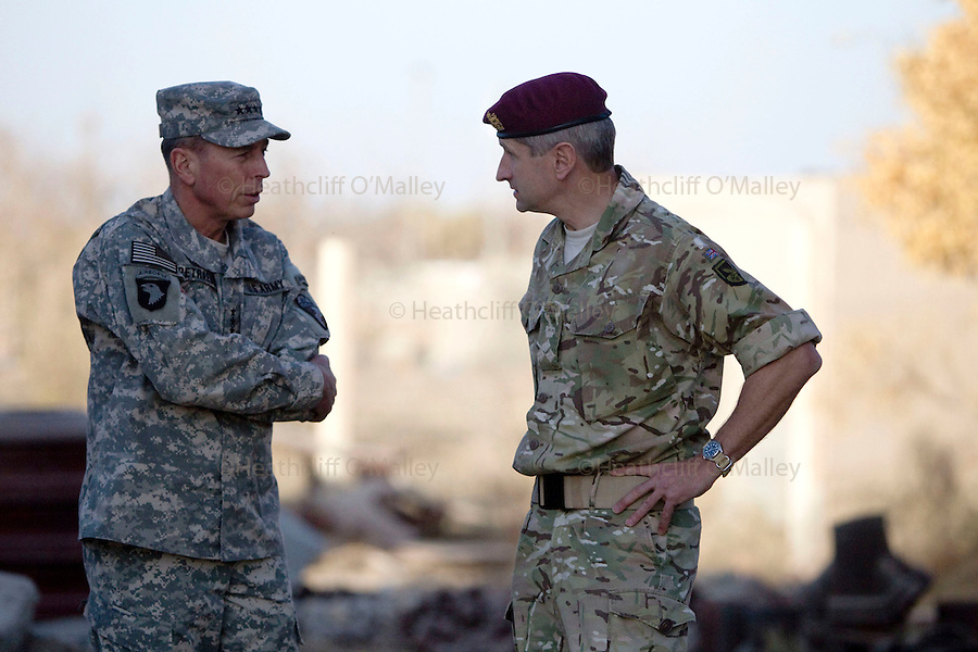 Mcc0027461 . Daily Telegraph..General David Petraeus , Commanding General of ISAF , talking with Brigadier James Chiswell during his visit to FOB Shahzad where the 3 Para Battlegroup are based in the northern Nad e Ali district of Helmand Province...Helmand 29 November 2010