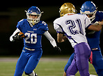 SIOUX FALLS, SD - OCTOBER 25: Parker Nelson #20 from Sioux Falls Christian looks for running room past Trevor Peters #21 from Winner in the first half of their 11B playoff game Thursday nigh at Bob Young Field in Sioux Falls.(Photo by Dave Eggen/Inertia)