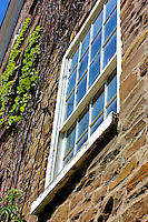 View of a rustic window on the side of the stone mill at Black Creek Pioneer Village in Toronto Canada