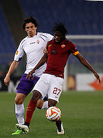 Calcio, Europa League: Ritorno degli ottavi di finale Roma vs Fiorentina. Roma, stadio Olimpico, 19 marzo 2015.<br /> Roma's Gervinho, right, is challenged by Fiorentina's Stefan Savic after scoring on a penalty kick during the Europa League round of 16 second leg football match between Roma and Fiorentina at Rome's Olympic stadium, 19 March 2015.<br /> UPDATE IMAGES PRESS/Isabella Bonotto