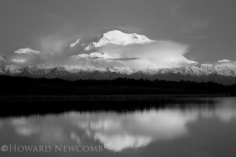 Sunset and reflection of Mt. McKinley at midnight.  Reflection Pond, Denali National Park, Alaska.