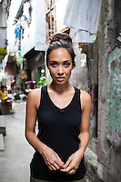 Myleene Klass, a celebrity from the UK, poses for a portrait after an underprivileged single mother Josephine Savares, 18, in her neighbourhood, in Paranaque City, Metro Manila, The Philippines on 19 January 2013. After watching advertisements, Josephine had decided to feed her baby formula during her pregnancy and had no idea that her father had to pay such a high price for it. Her family goes without food some days, and her siblings have had to stop school in order to afford the formula. Photo by Suzanne Lee for Save the Children UK